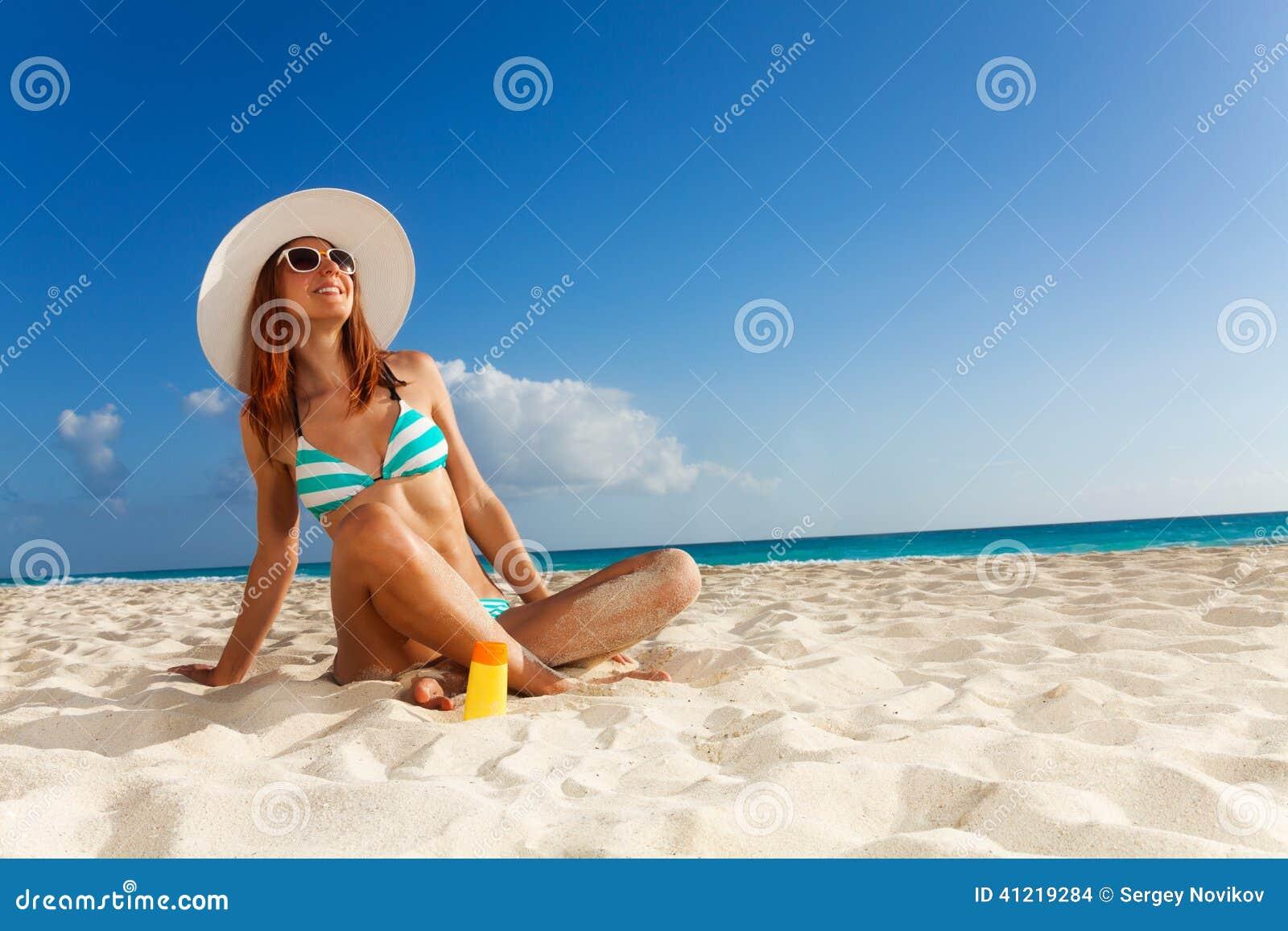 acb62089540 Girl Sunbathing On White Sand Beach Stock Photo - Image of beach ...
