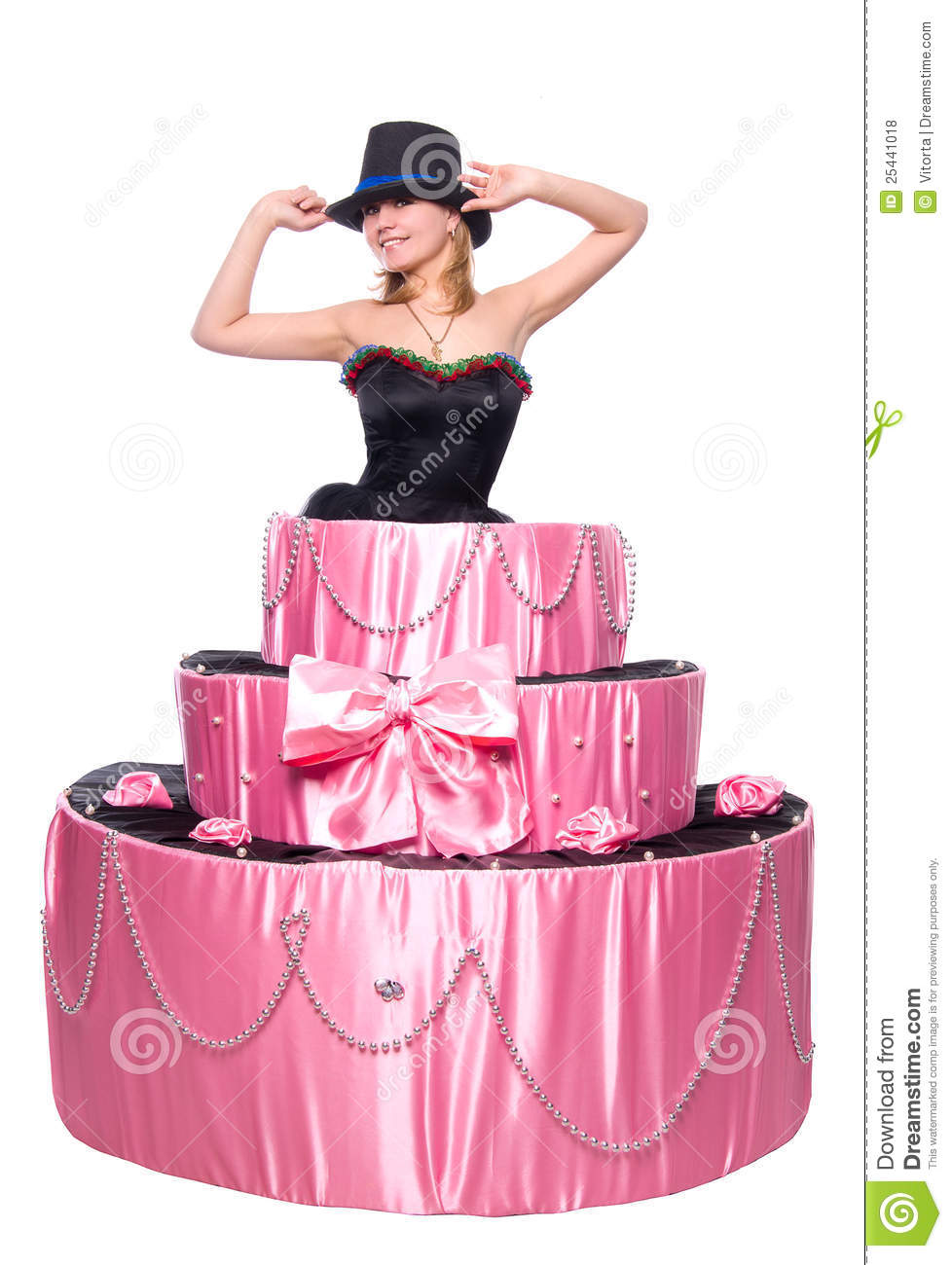 Beautiful girl, a surprise gift, jumps out of the toy cake, isolated ...