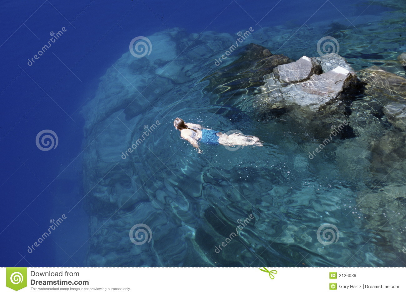 Girl Swimming In Crater Lake Royalty Free Stock Images