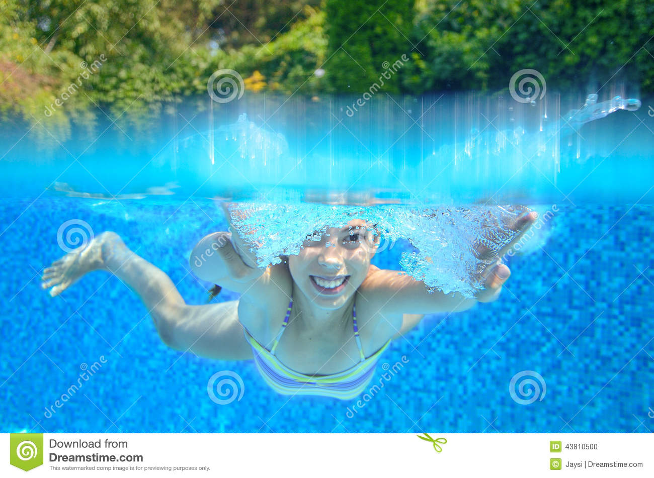 Girl Swims In Swimming Pool, Underwater And Above View ...