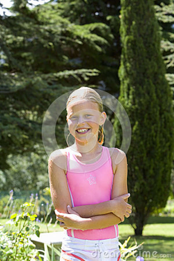 girl 911 in swimsuit with arms crossed in garden