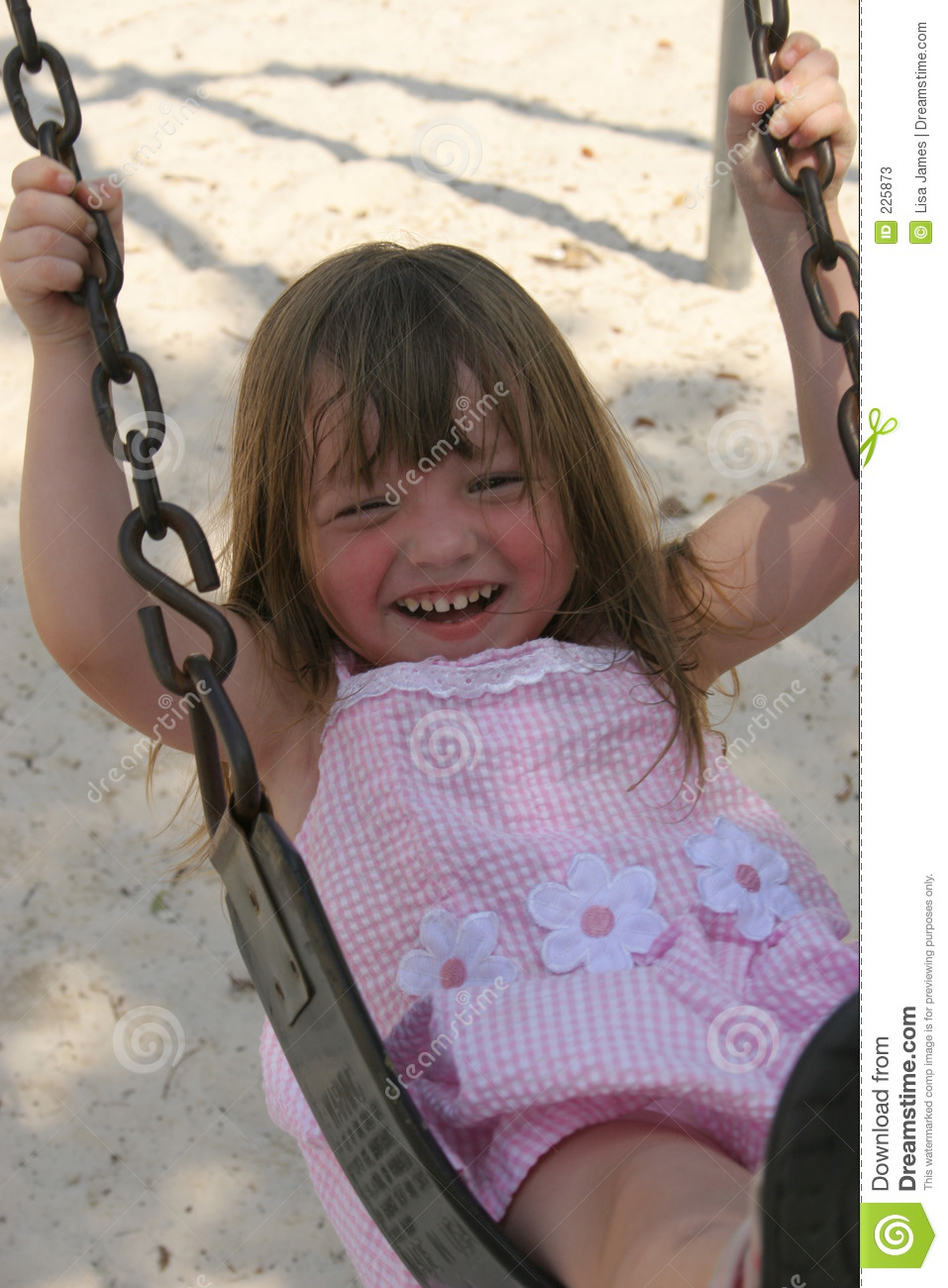 Girl on swing with smile