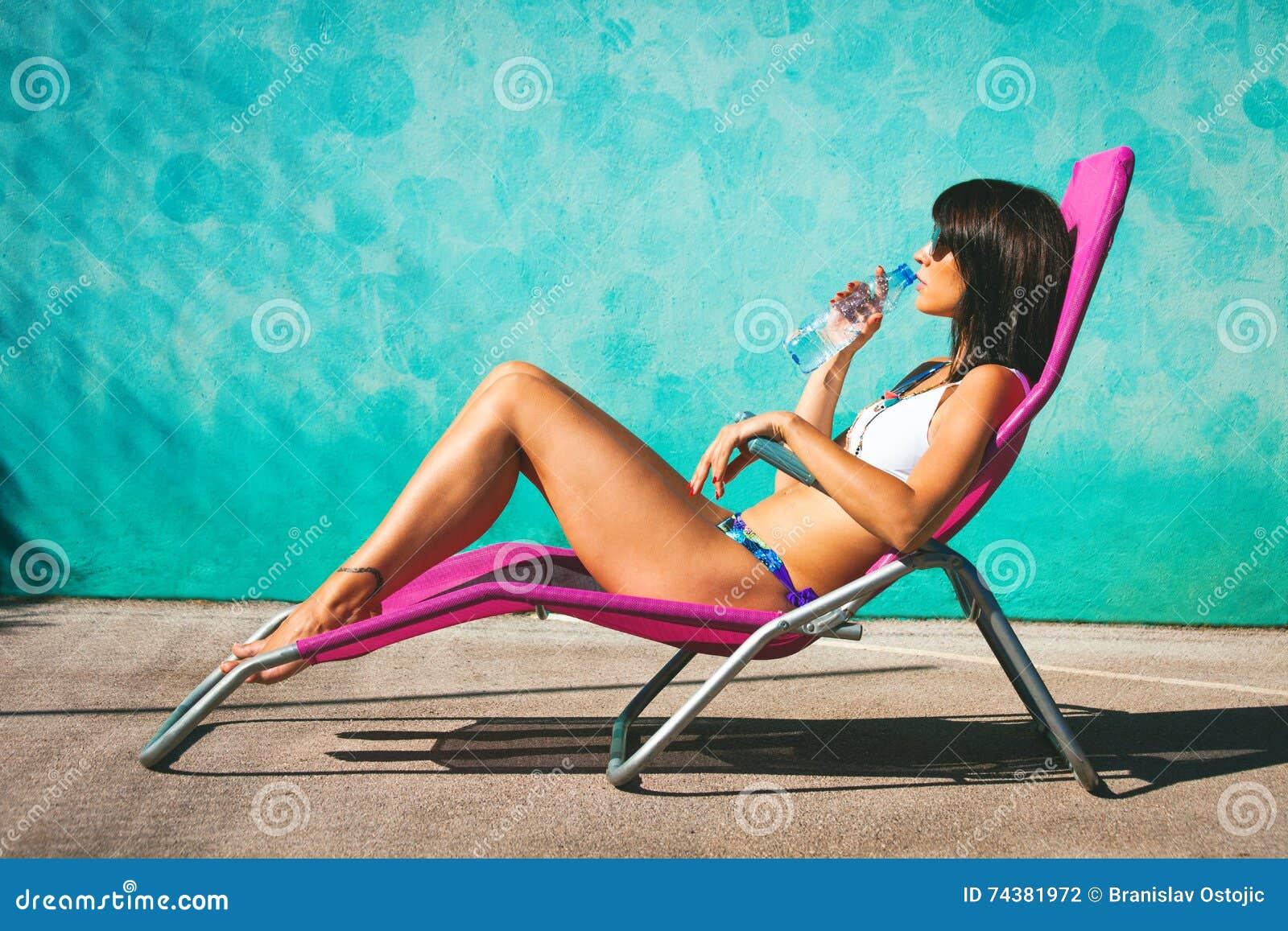 Girl take sunbath