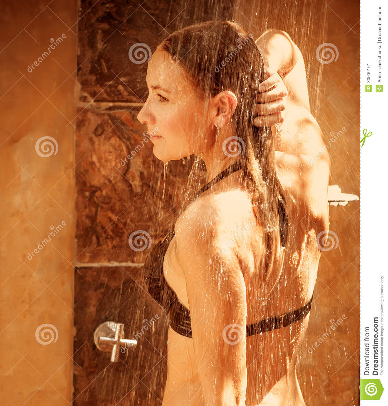 Naked woman in the outdoor shower very