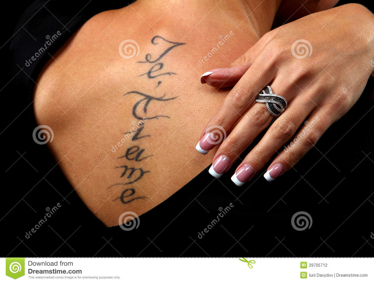 Girl with a tattoo on the back of which is a hand with a for Hand tattoo download