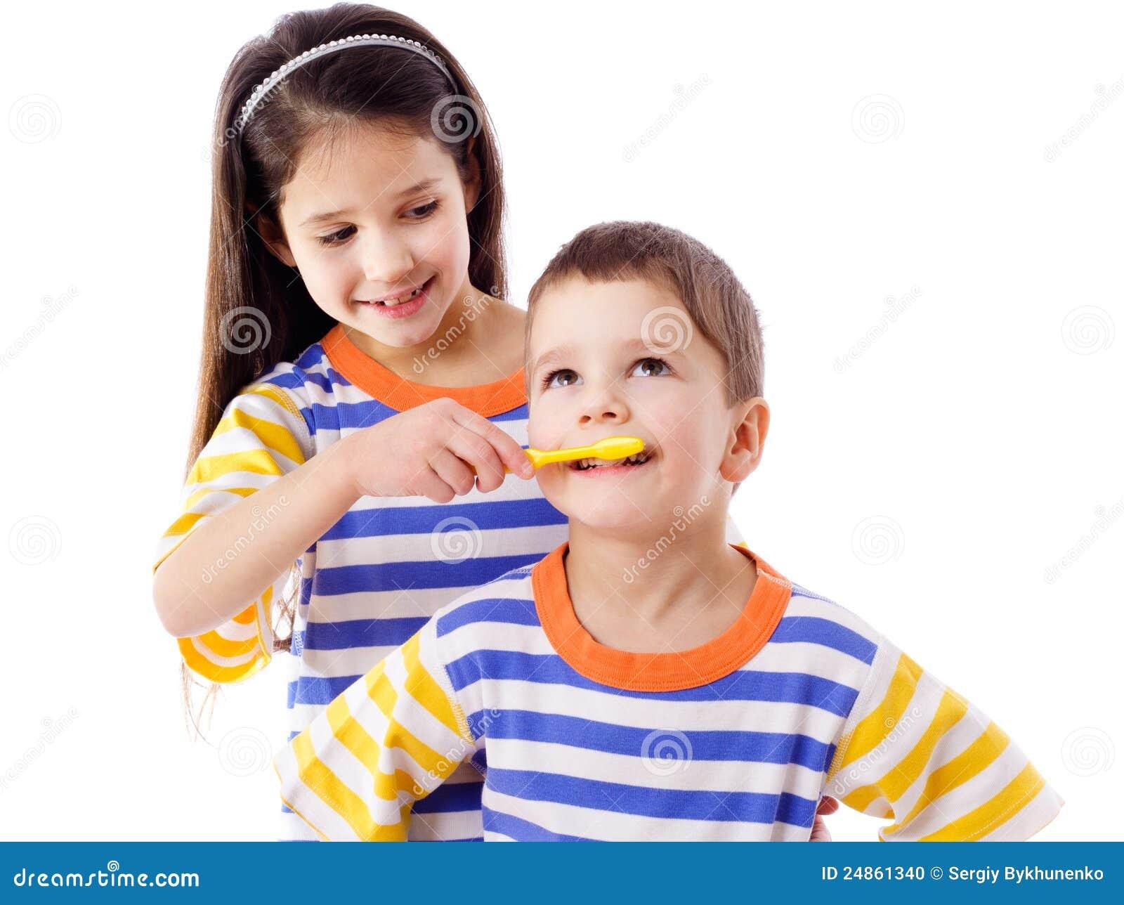 Girl teaches a boy to brush your teeth