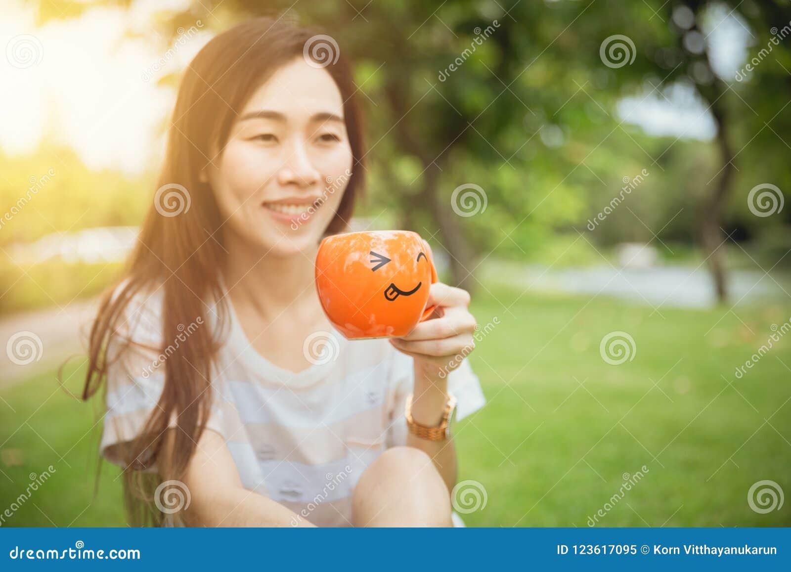 Girl teen hand holding smile mug for hot drink morning