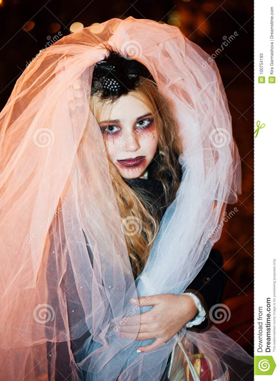 girl teenager in the image of a dead bride zombie on halloween