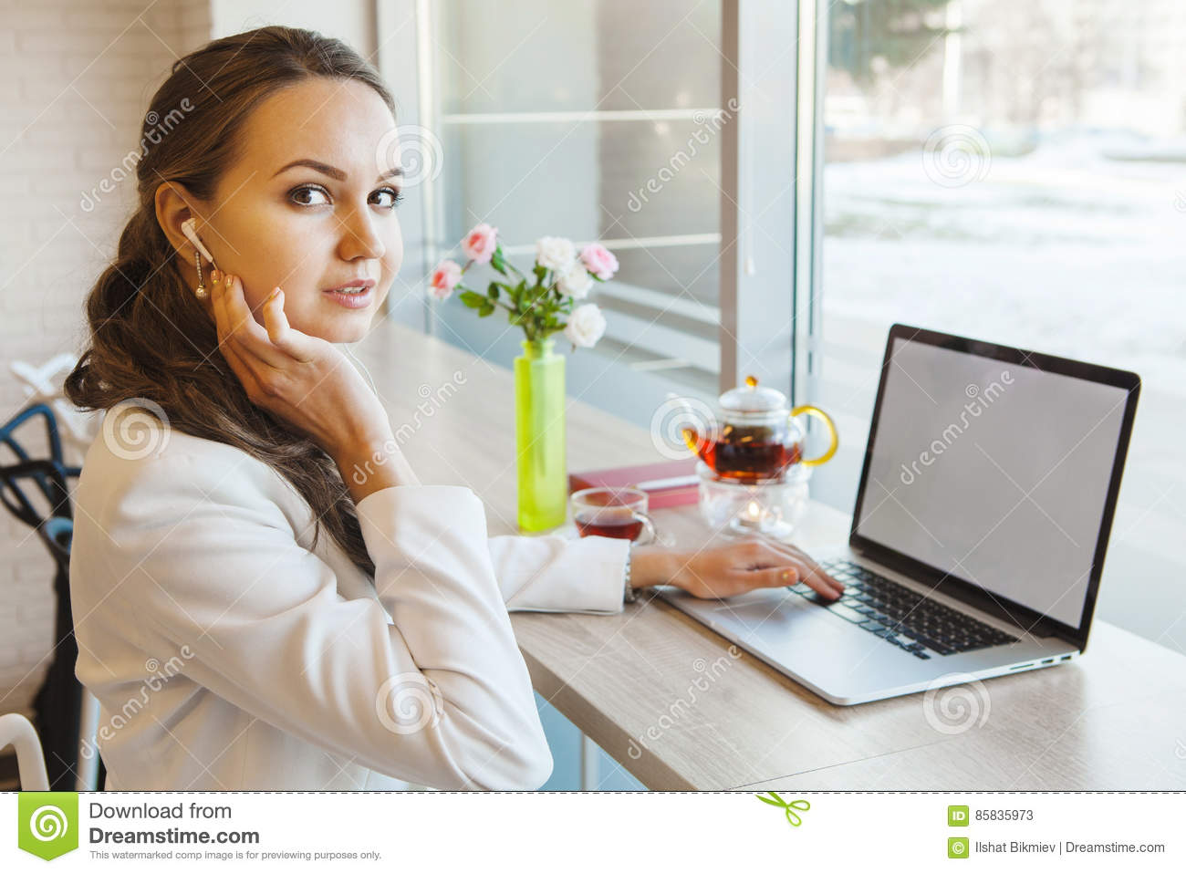 Girl with telephone headset working on computer