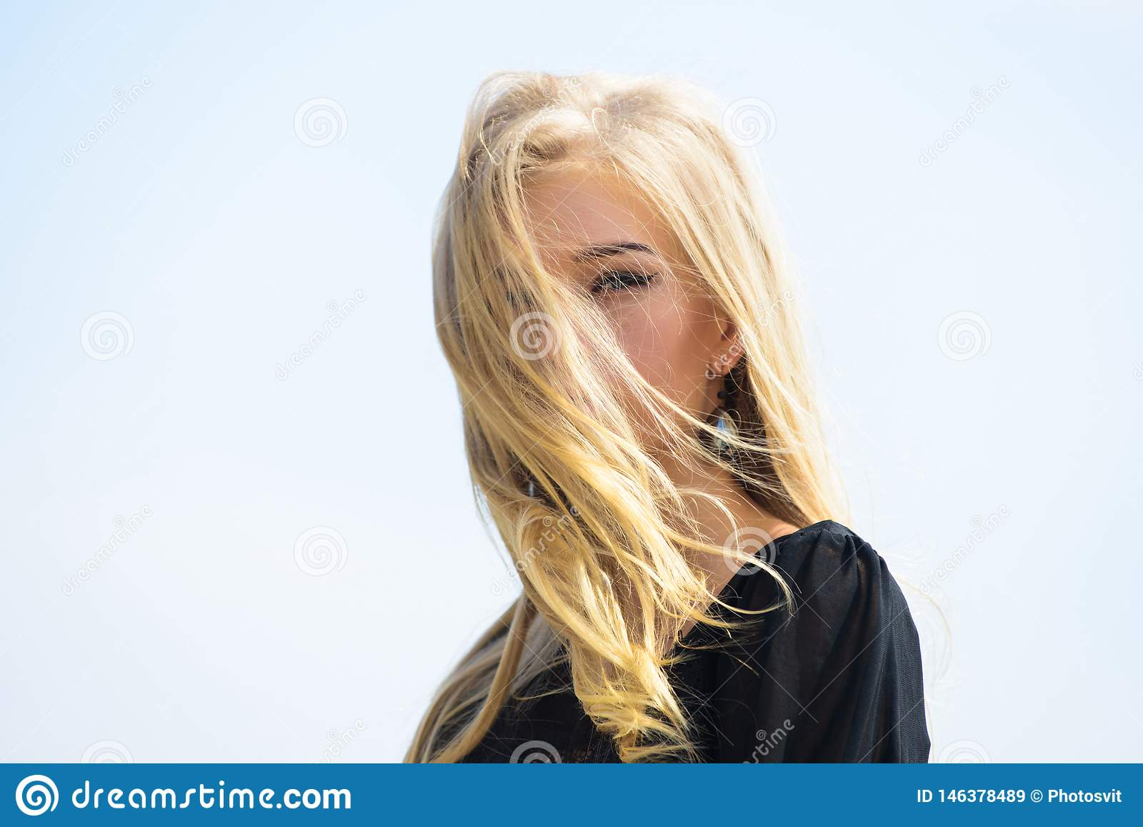 Girl tender blonde makeup face sky background. Bleaching roots. How to repair bleached hair fast and safely. How to take