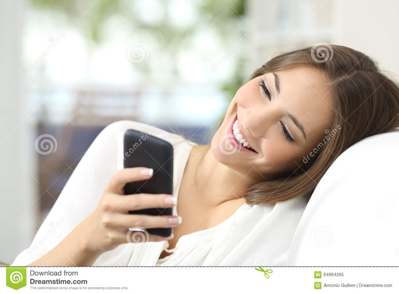 Girl Texting On A Mobile Phone At Home Stock Photo Image