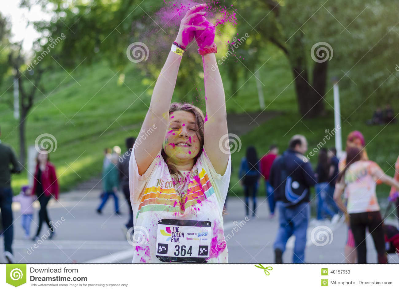 Girl throwing pink powder at Color Run Bucharest