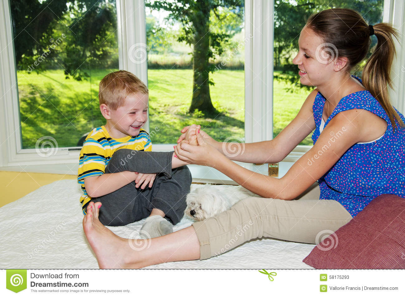 Girl Tickling Childs Foot Stock Photo Image 58175293