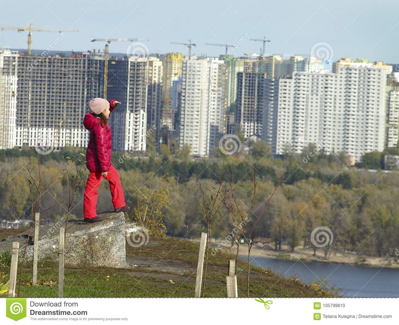 Girl from the top looks at the city of Kiev.