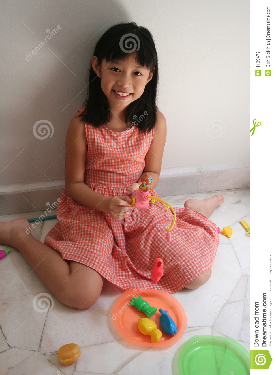 Girl with toy fishing rod