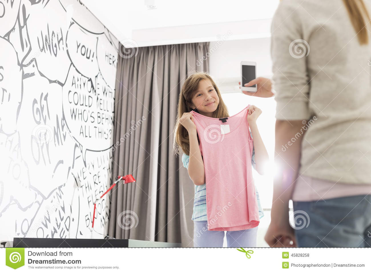 Daughter trying on clothes for daddy039s friend