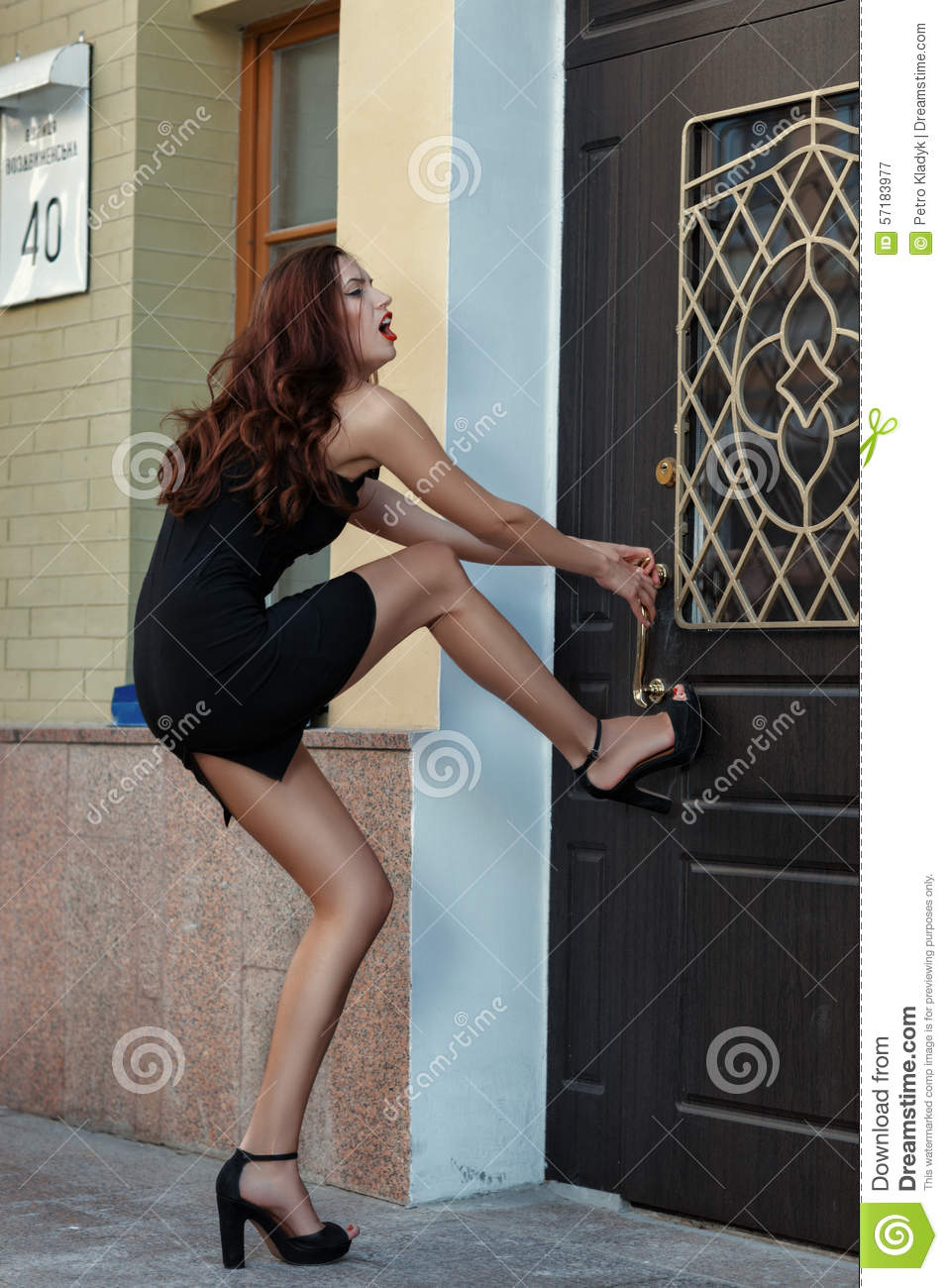 Girl Trying To Open The Door And Hysteria Stock Photo