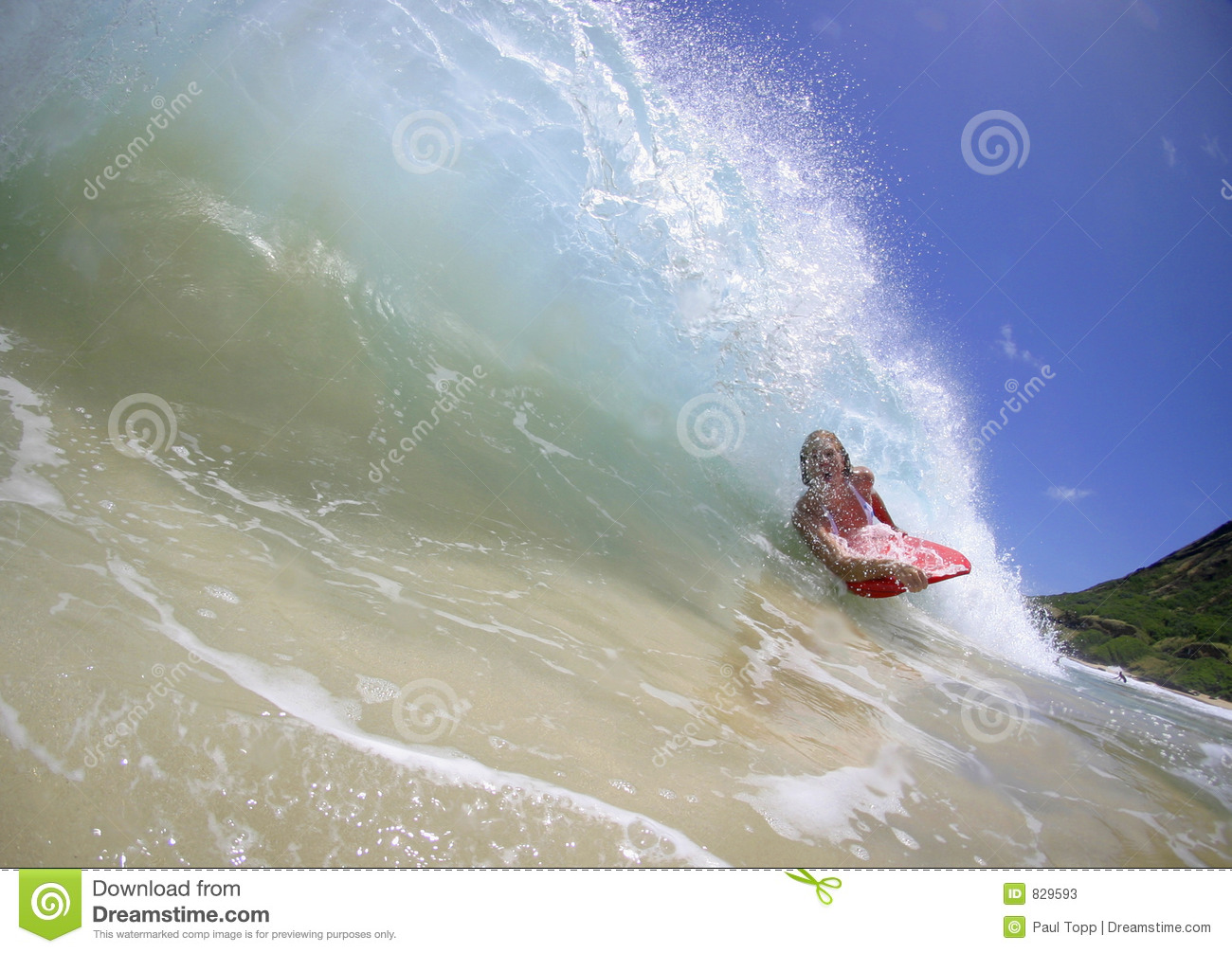 Girl in the Tube of a Surfing Wave