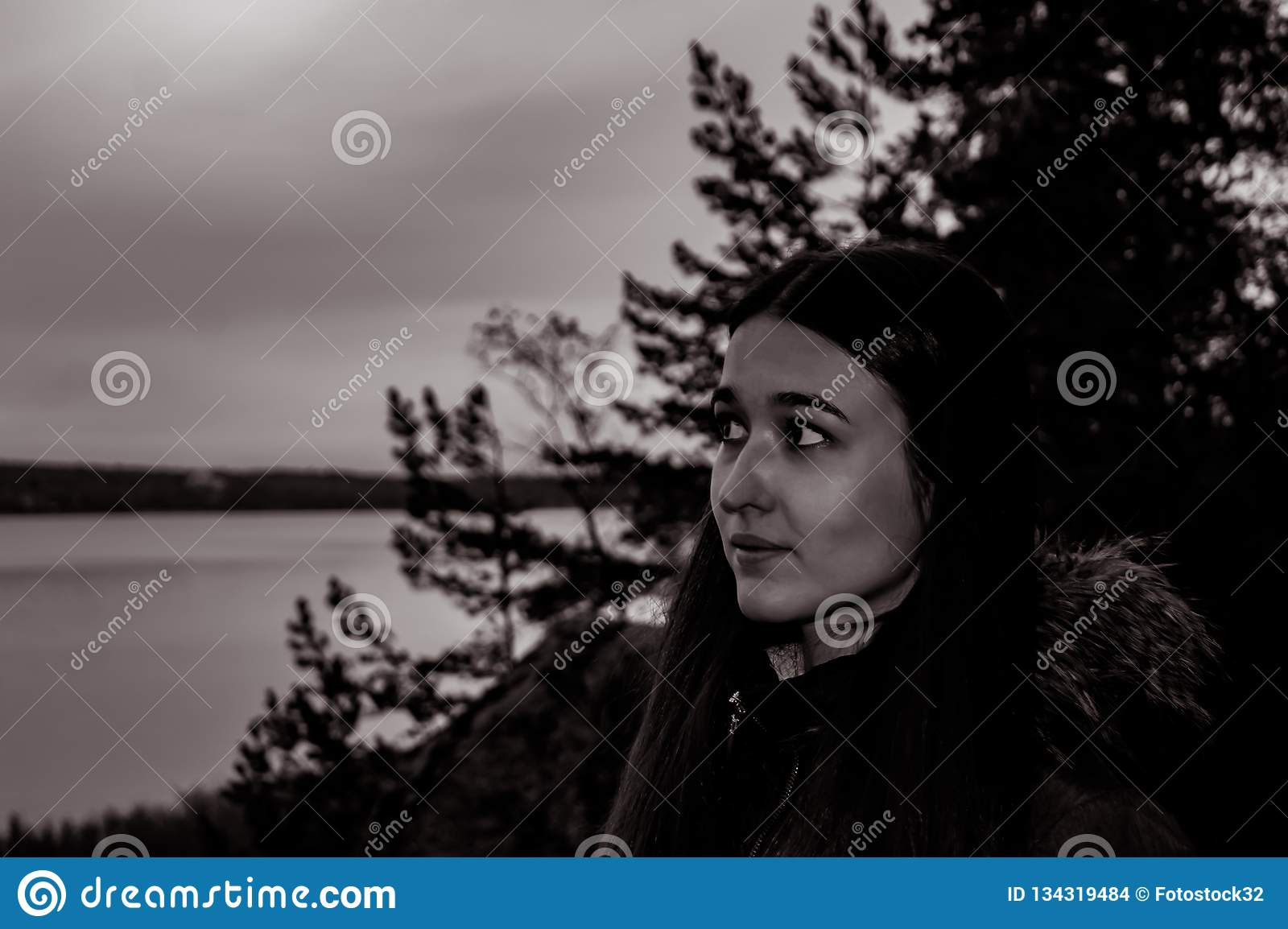 Girl in the twilight forest