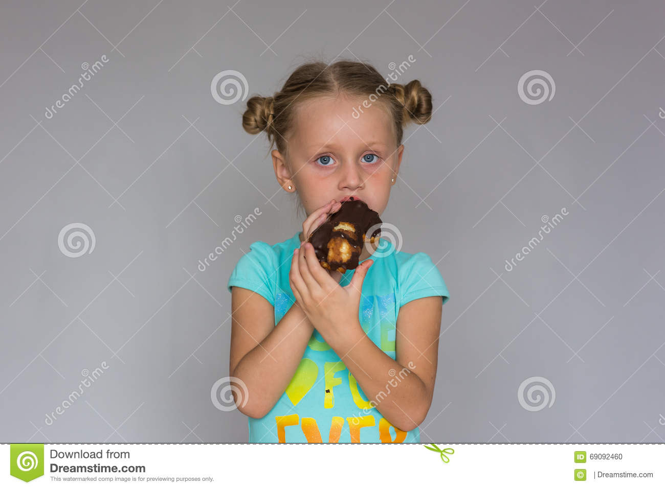 The Girl With Two Plaits Biting A Chocolate Cake Stock Photo Image