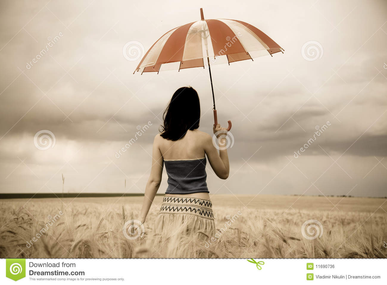 Girl With Umbrella At Field. In Storm Royalty-Free Stock ...