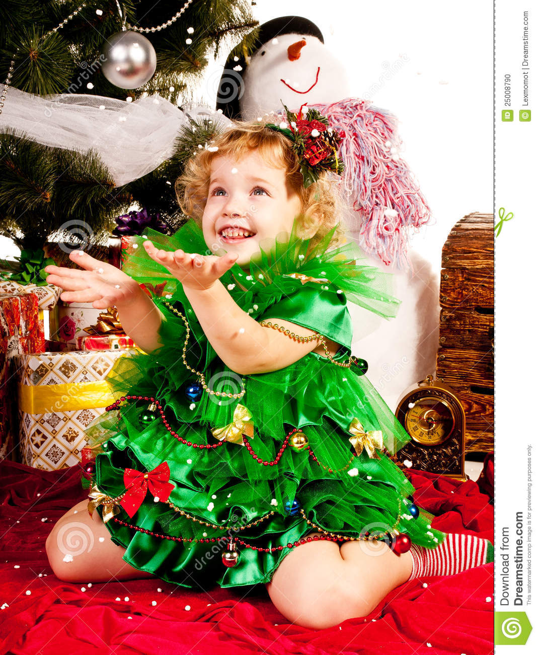 Little Girl Christmas Tree: A Girl Under The Christmas Tree With Gifts Stock Photo
