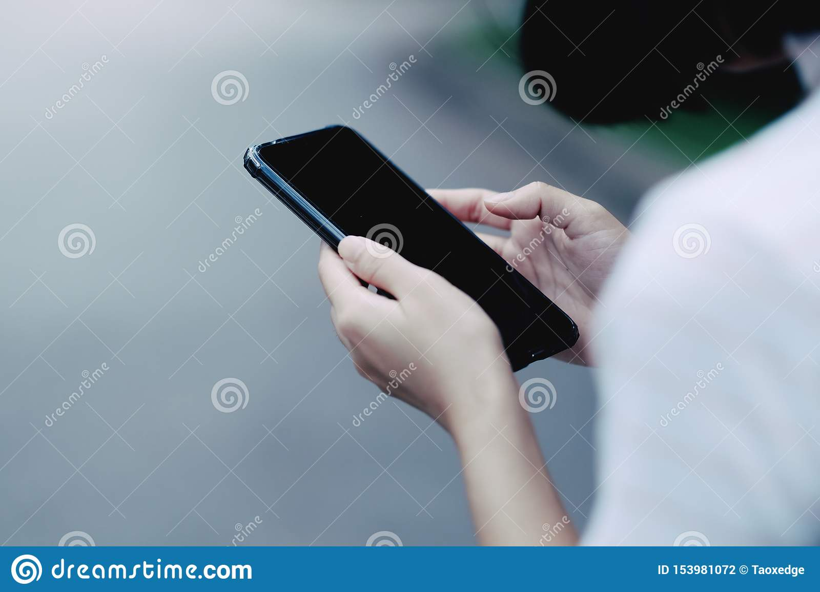 A girl using black smartphone for online shopping