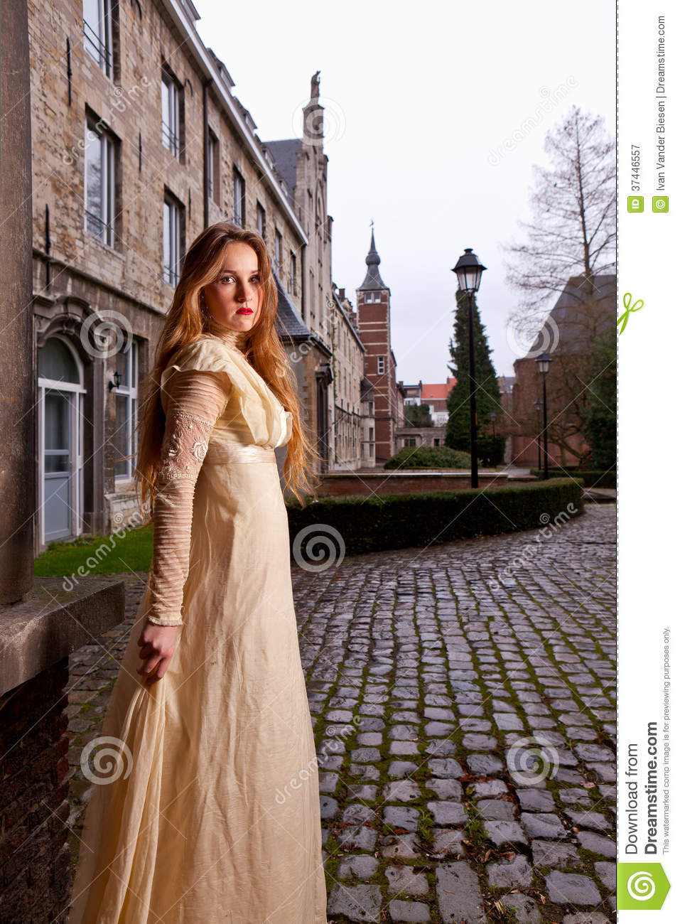 Girl in Victorian dress in a old city square