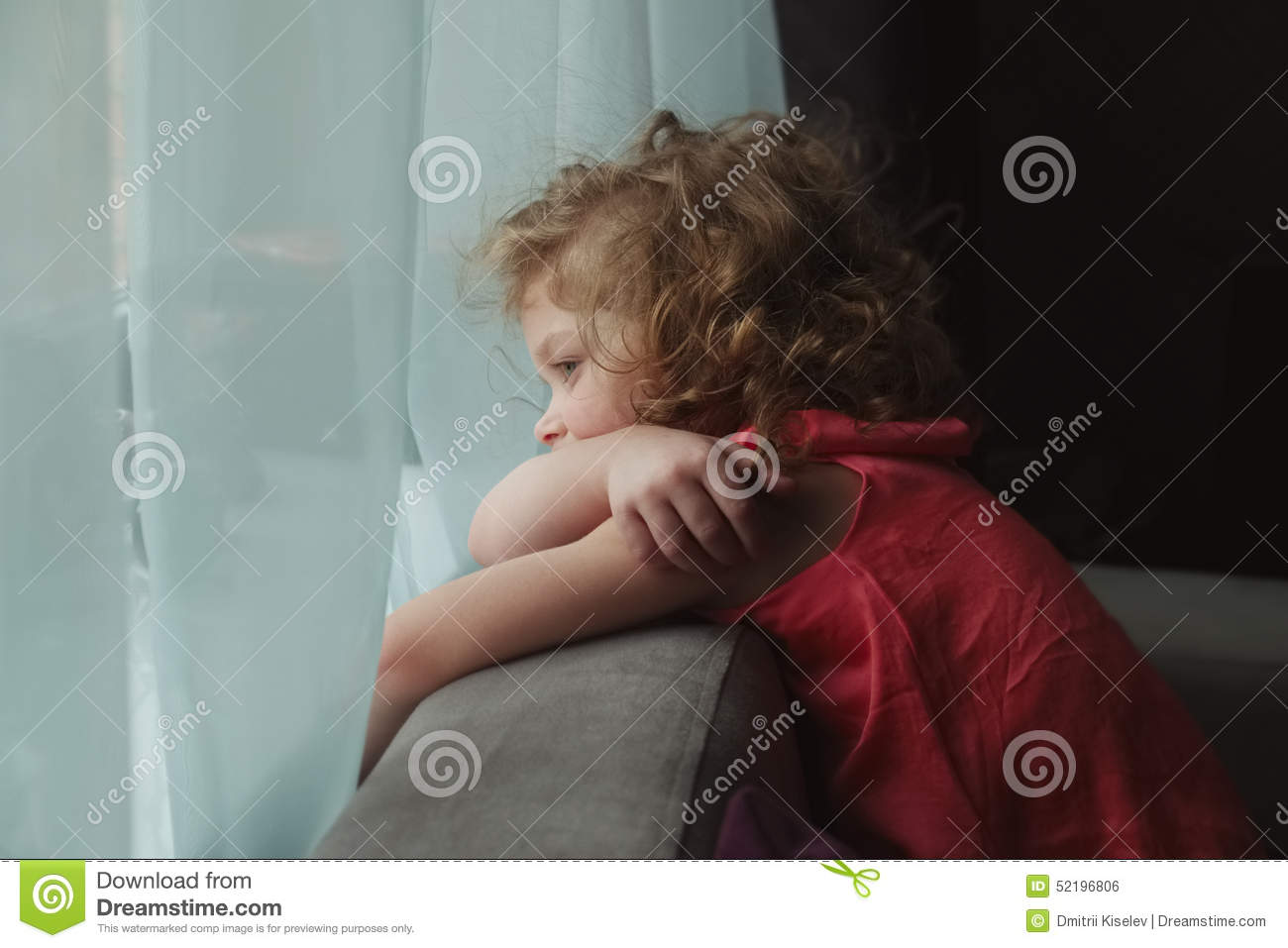 Girl Waiting For Someone And Looking Out The Window Stock Photo