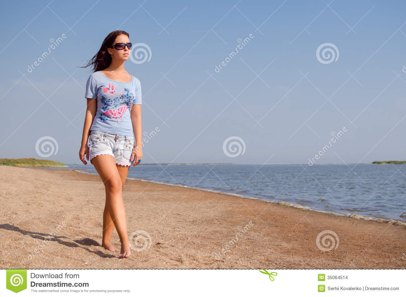 Woman walking on a beach royalty - Girl Walking On The Beach Royalty Free Stock Photo