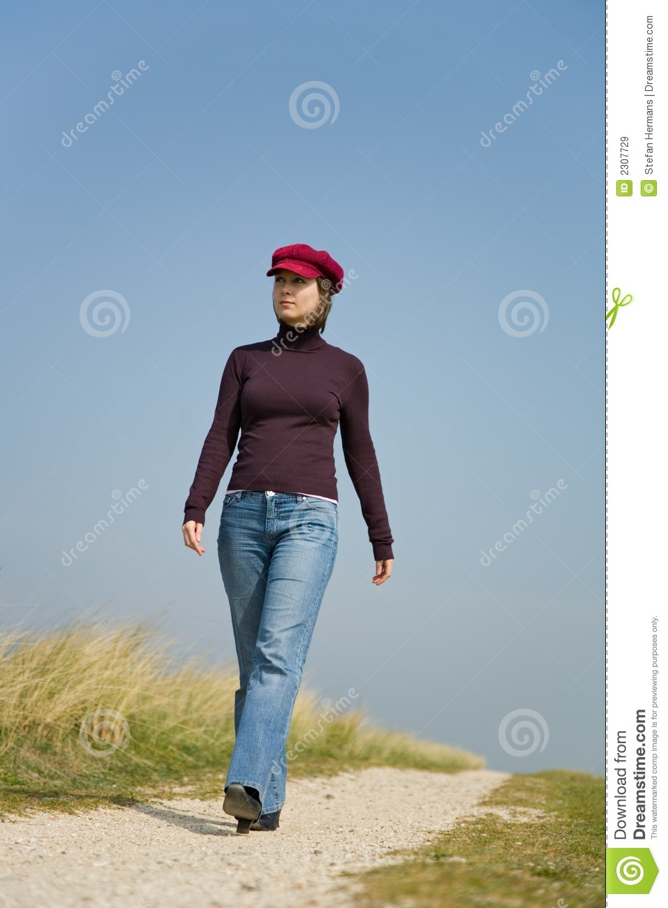 girl walking down the road royalty free stock images