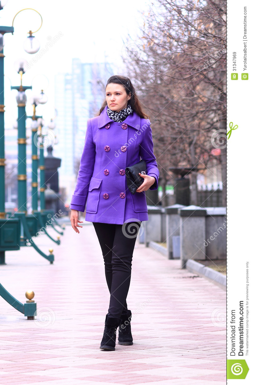 Beautiful girl walking down the street