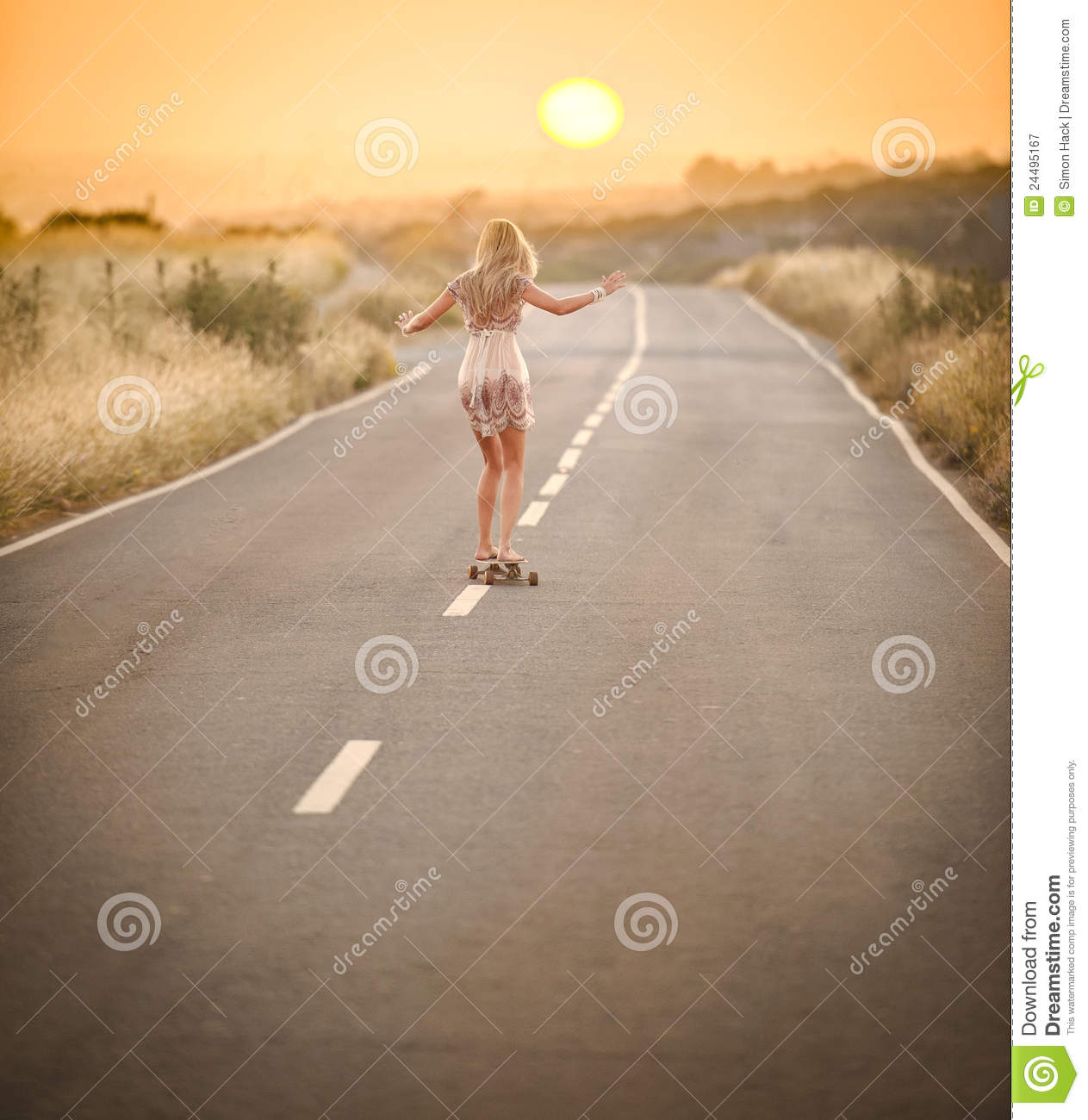 Girl walking with her skateboard 2