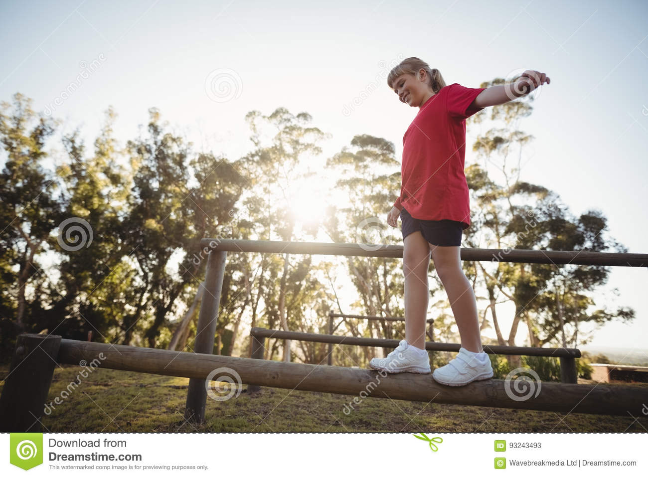 Girl walking on obstacle during obstacle course