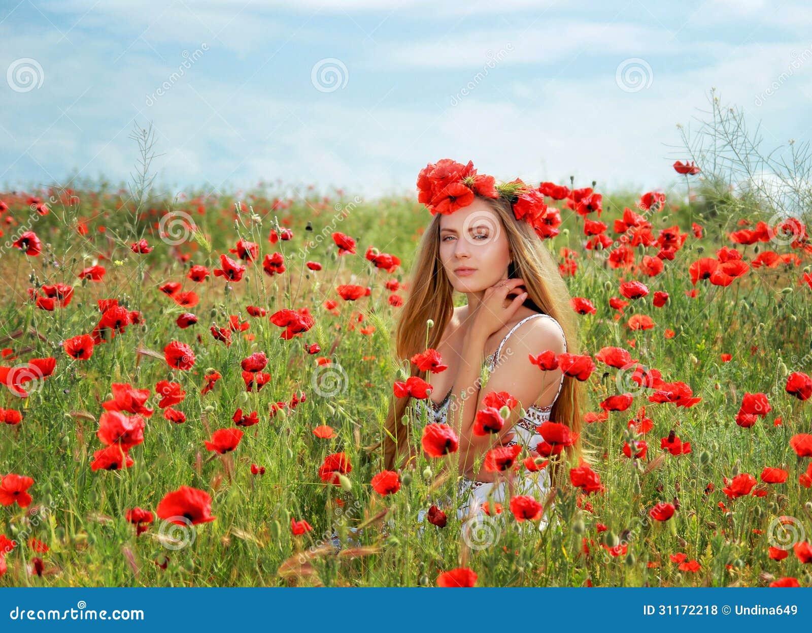 girl walking in poppy field stock photo image of hair field 31172218