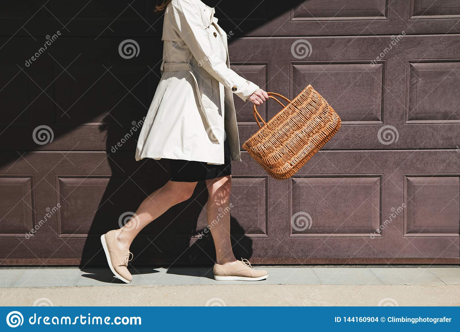 Girl walking with shopping bag in the street