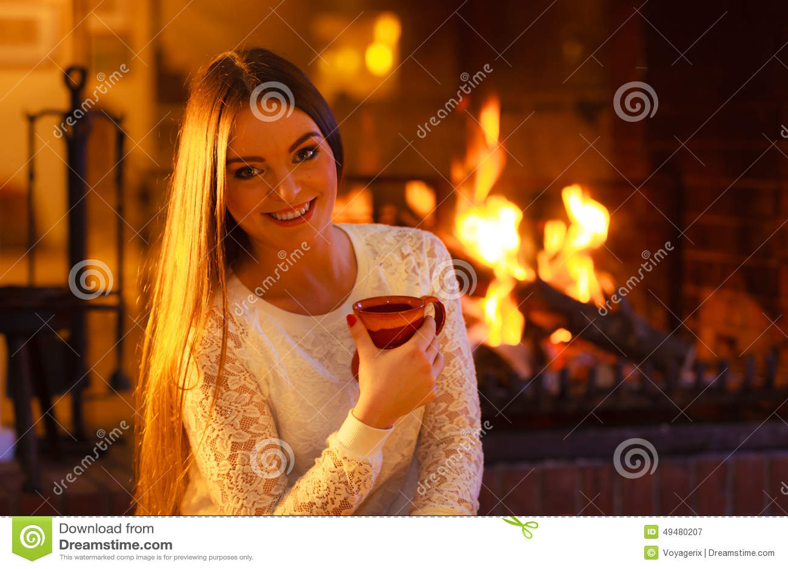 Woman Drinking Coffee Fireplace