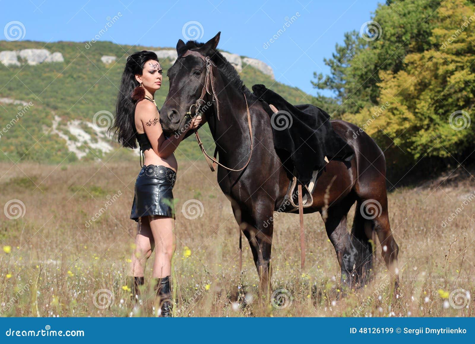 Girl Warrior Amazon With A Black Horse Stock Photo