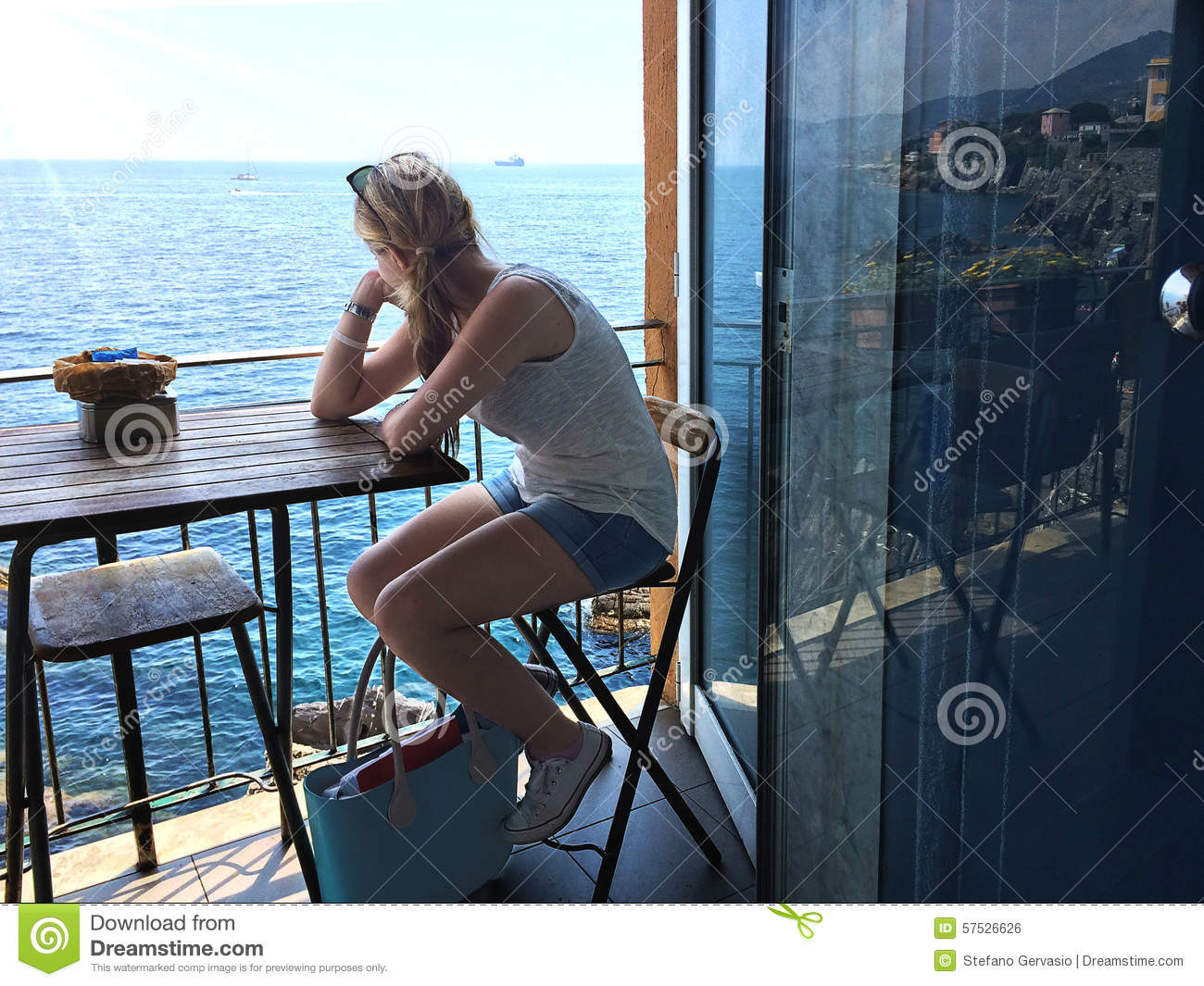 Girl watch sea from the balcony stock photo image 57526626 for On the balcony