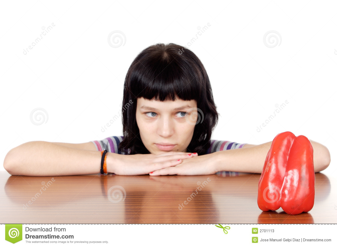 Girl watching a red pepper