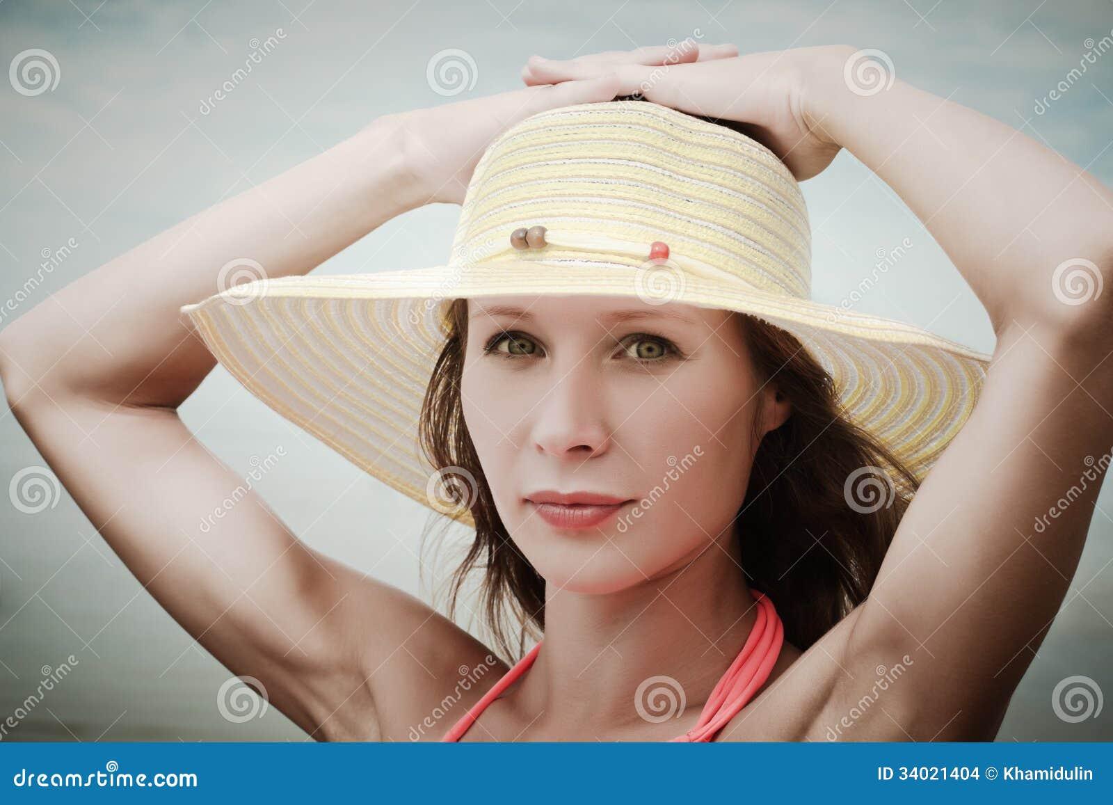 Girl wearing bikini and hat