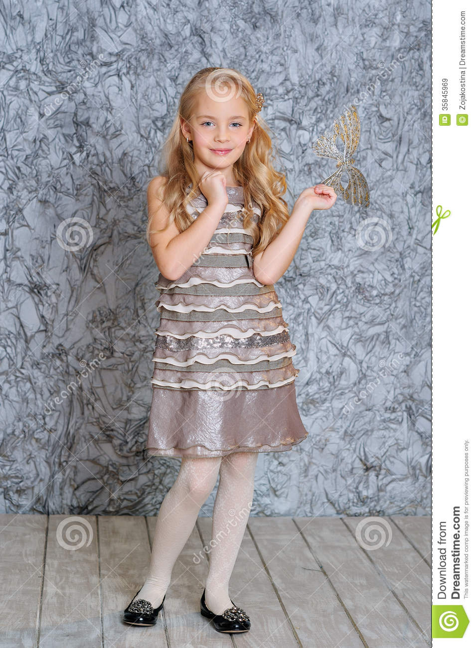 Girl Wearing Fashion Dress And A Mask Royalty Free Stock