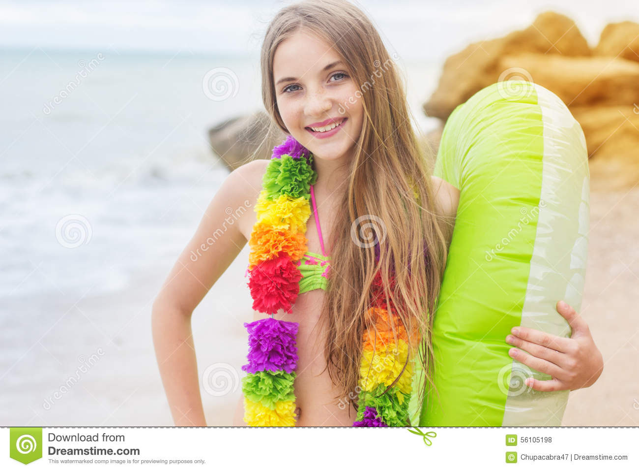 Girl is wearing hawaiian flowers with rubber ring stock photo download girl is wearing hawaiian flowers with rubber ring stock photo image of little izmirmasajfo