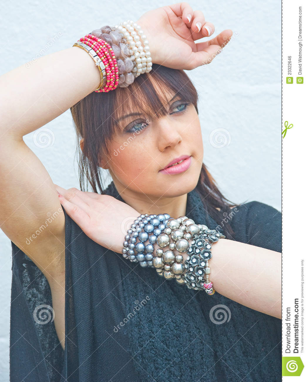 Girl Wearing Jewelry On Both Wrists. . Royalty Free Stock ...