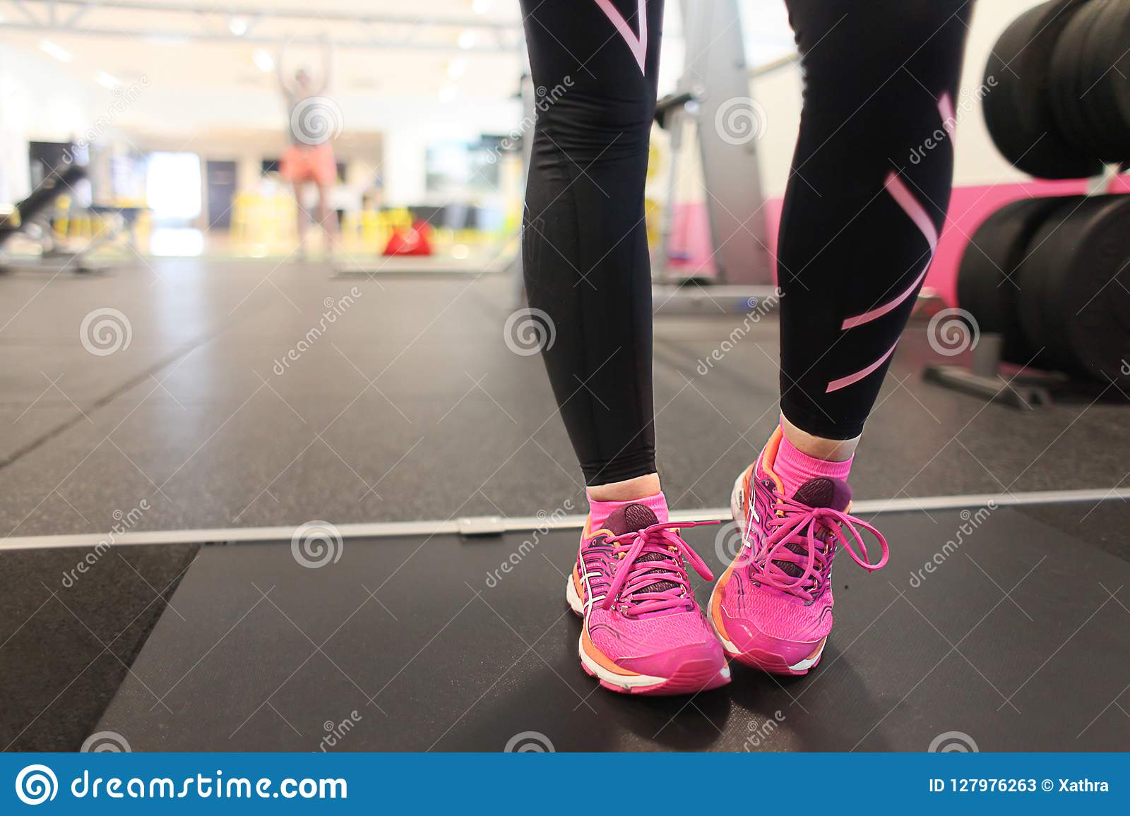 Girl Wearing Pink Running Shoes On