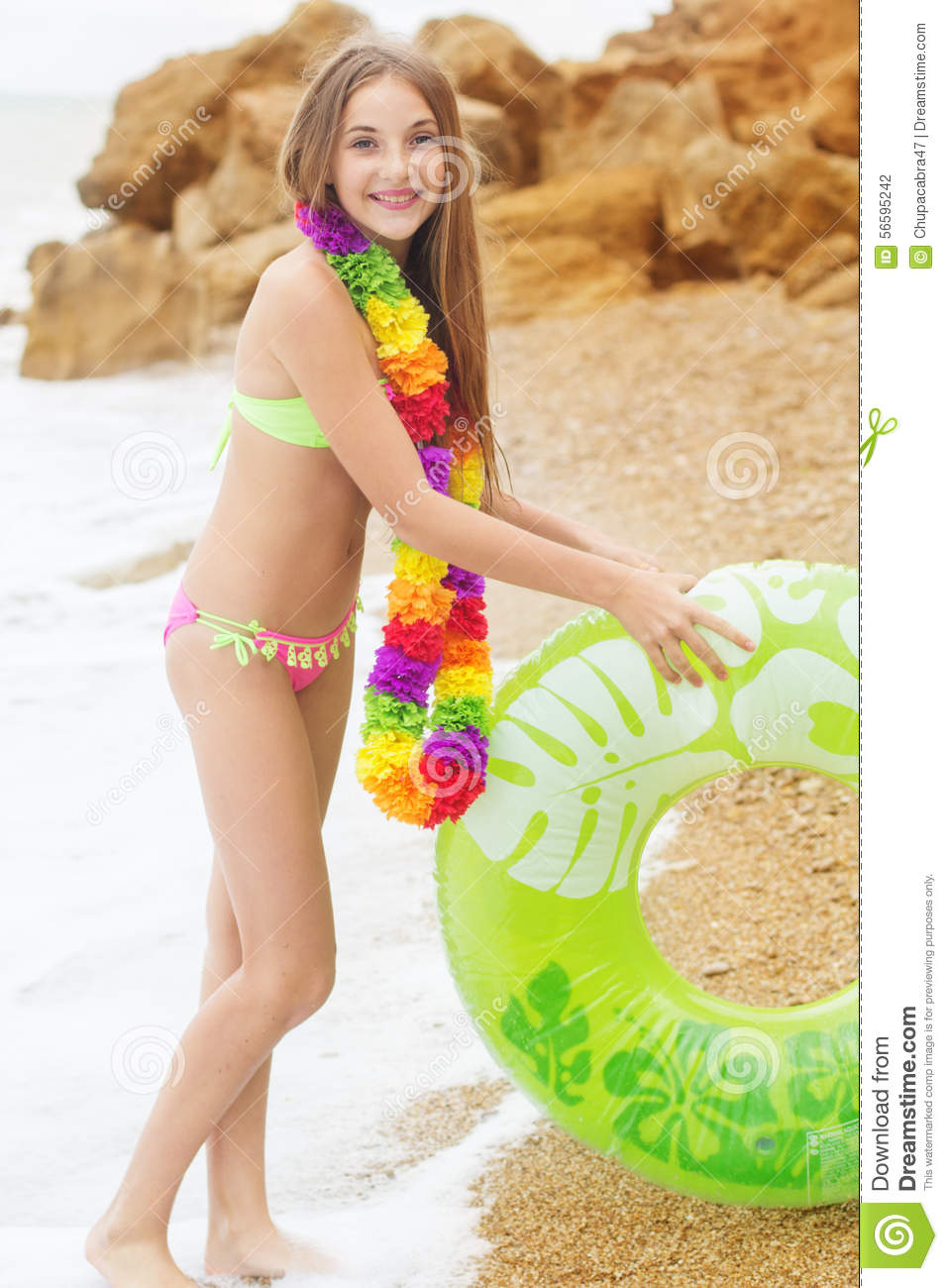Girl Is Wearing Swimsuit With Green Rubber Ring Stock