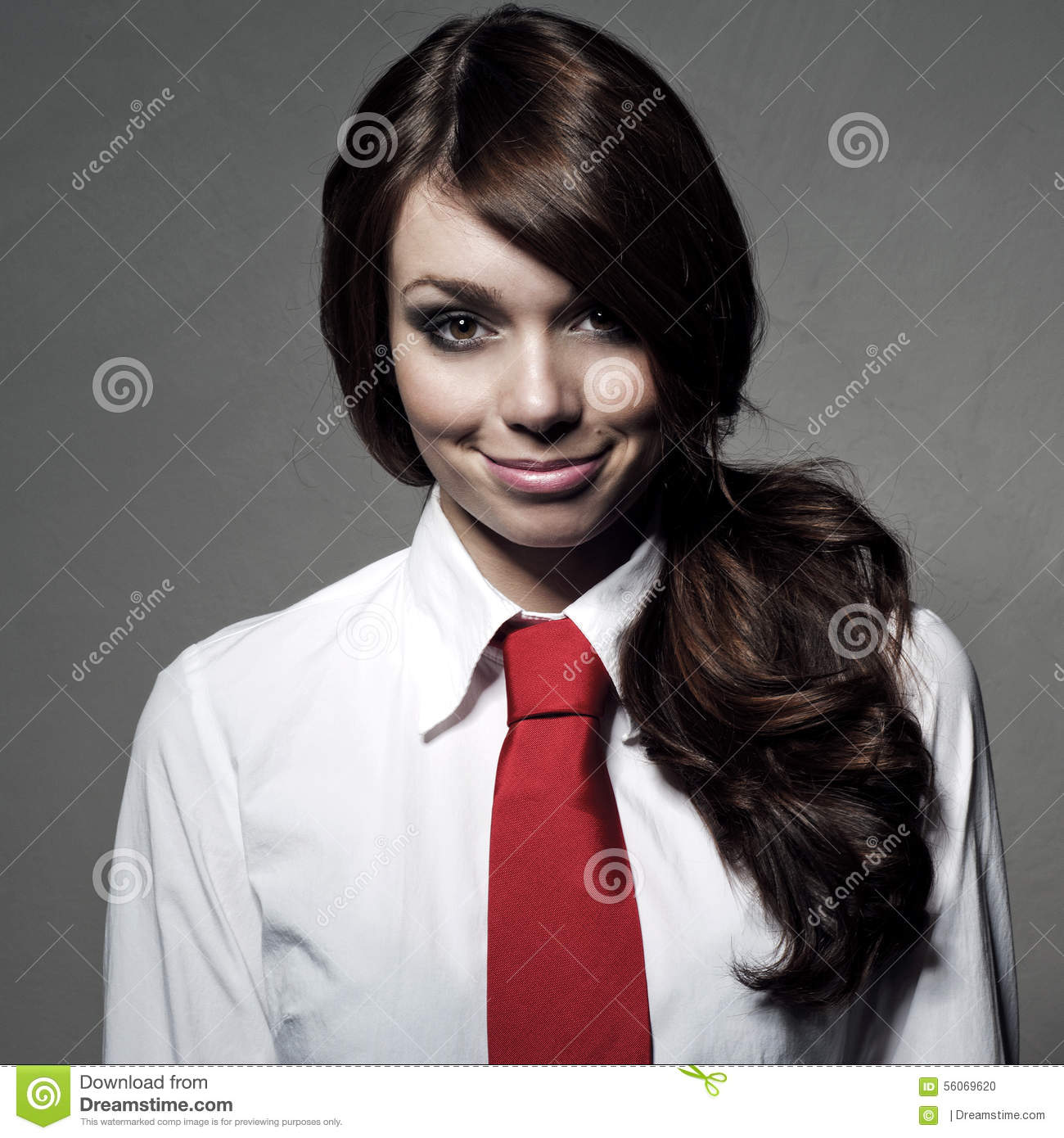 The Girl Is Wearing A White Shirt And Red Tie Stock Photo ...