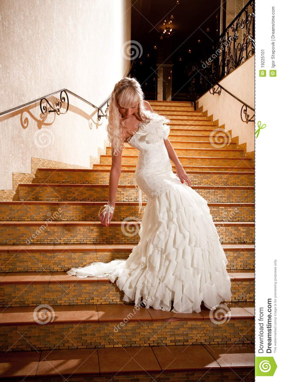 Girl in a wedding dress going down the stairs stock image for Going to a wedding dress
