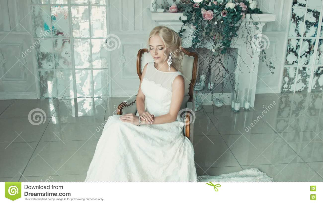 The Girl In A Wedding Dress Smiling And Glancing From Side To Side ...