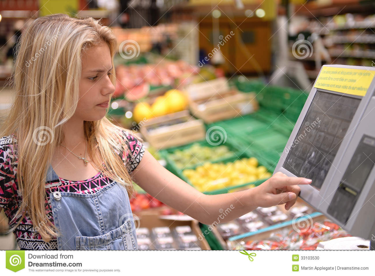 Girl weighing goods in shop